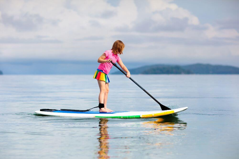Kid enjoying SUP board